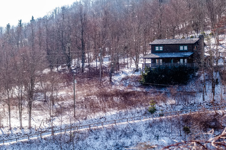 hardwoods: log cabin on a side of a mountain during winter