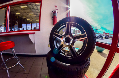 tire: car tires on display for sale at a tire shop store
