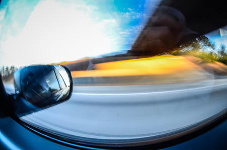 closer: driving in car on highway,with views in windshiel and side window Stock Photo