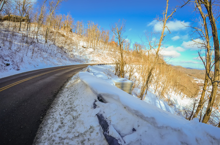 winter landscape wraps around the road curve photo