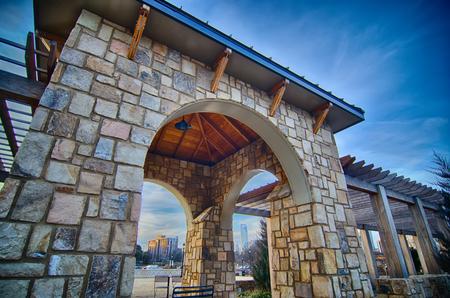 cultured stone terrace trellis details near park in a city  Reklamní fotografie