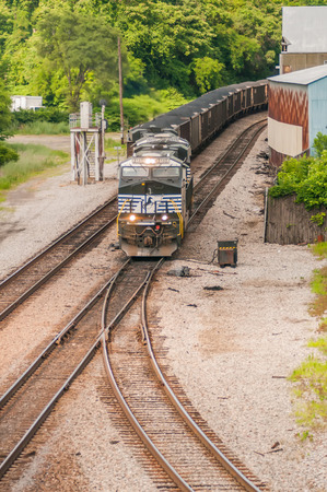 slow moving Coal wagons on railway tracks Editorial