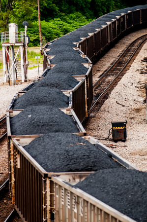 slow moving Coal wagons on railway tracks Stock Photo