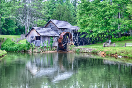 grist mill: Historic Edwin B. Mabry Grist Mill (Mabry Mill) in rural Virginia on Blue Ridge Parkway and reflection on pond in summer Stock Photo