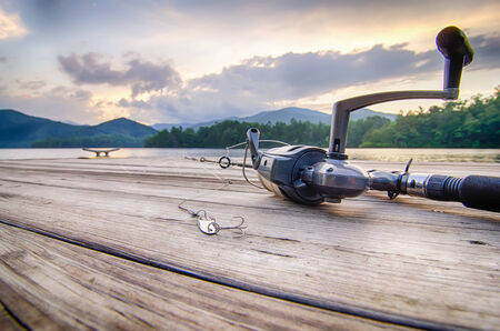 fishing tackle on a wooden float with mountain background