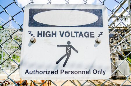 white and black danger warns trespassers away from this substation. photo