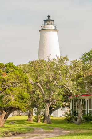 outer banks: The Ocracoke Lighthouse and Keepers Dwelling on Ocracoke Island of North Carolinas Outer Banks Stock Photo
