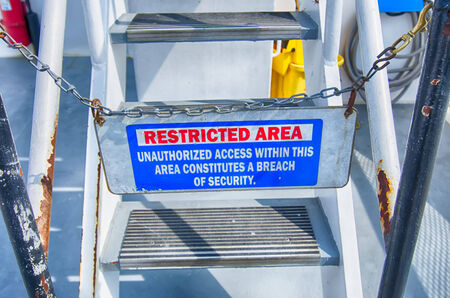 steel: Caution sign, restricted area on steel stair Stock Photo