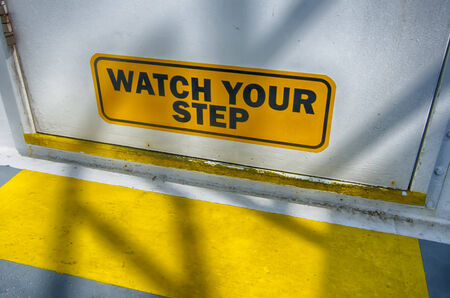 watch your step sign on the door
