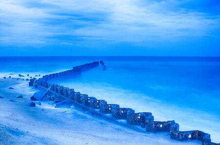 North Carolina OBX Retired Coastal Groyne Buxton Jetties on Old Lighthouse Beach Stock Photo