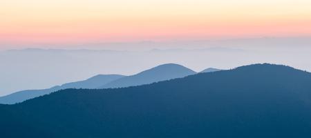 Panorama  of mountain ridges silhouettes