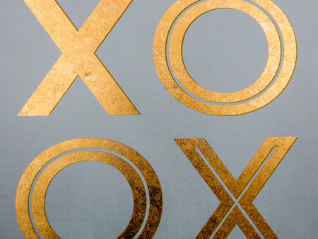 xoxo: golden xoxo letters on canvas board Stock Photo