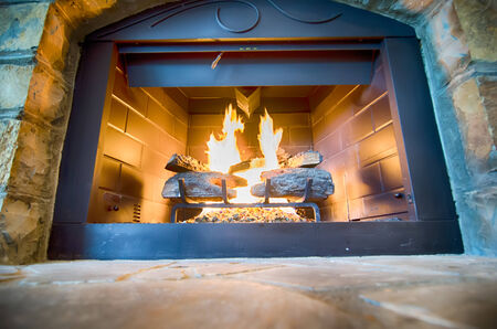 stone  fireplace: luxurious stone structure fireplace with burning fire