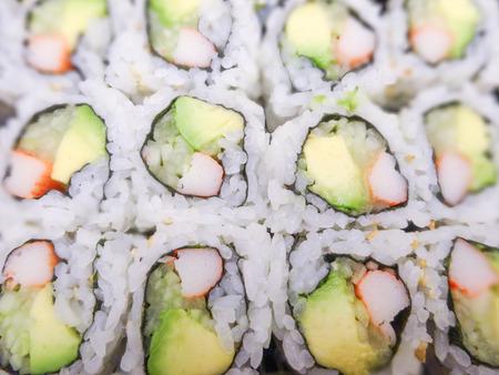 sushi with salmon and avocado rolls 版權商用圖片