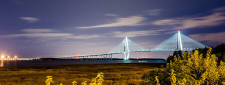 cooper: cooper river bridge at night in charleston south carolina