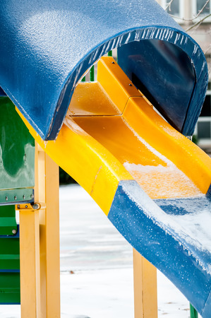 is covered: snow and ice covered playground