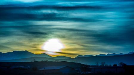 winter sunrise: sunrise over colorado rocky mountains
