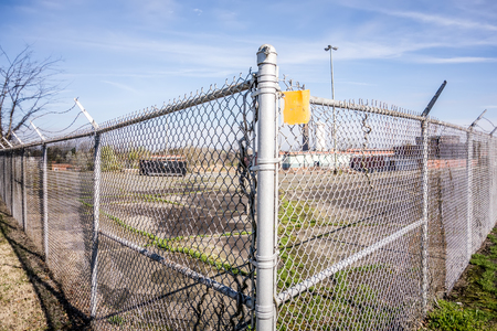 perimeter: chainlink fence securing perimeter of property