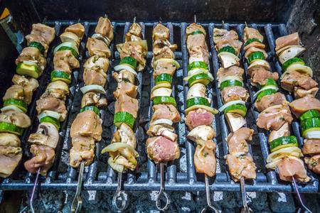 the shish kebab: shish kebab on skewers on a grill on a holiday