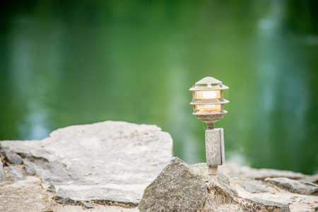 light fixture: mood lighting light fixture on rocks by the water
