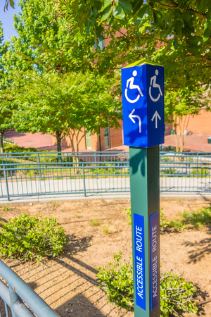 accessible: blue handicapped wheel chair post sign