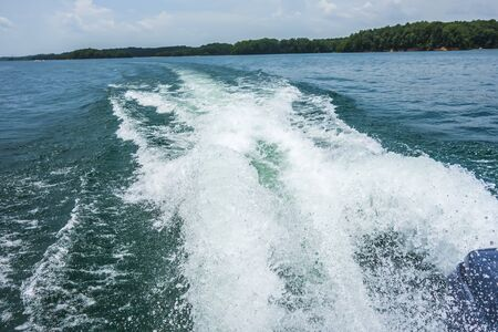 wake waves from boat on lake Stock Photo
