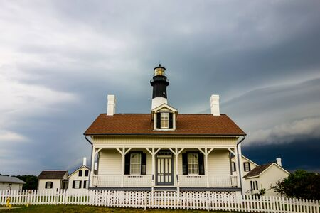 tybee island: tybee island beach lighthouse with thunder and lightning