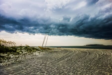 during: tybee island beach scenes during rain and thunder storm Stock Photo