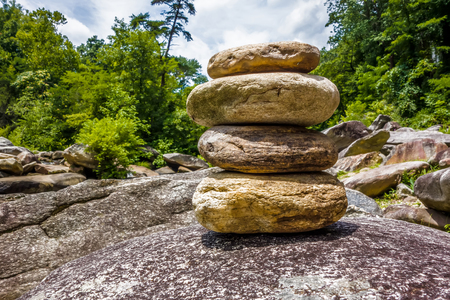 smooth stones: Stack of round smooth stones near mountain river
