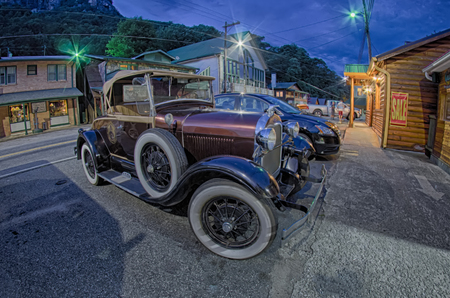 motorcars: beautiful classic ford car at night on city street