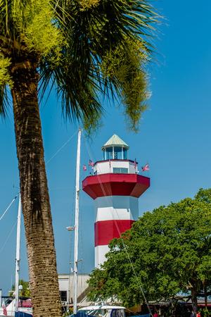 sc: A clear blue sky features the Harbour Town Lighthouse - famous landmark in Hilton Head, SC, USA