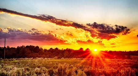 sun setting over country farm land in york south carolina