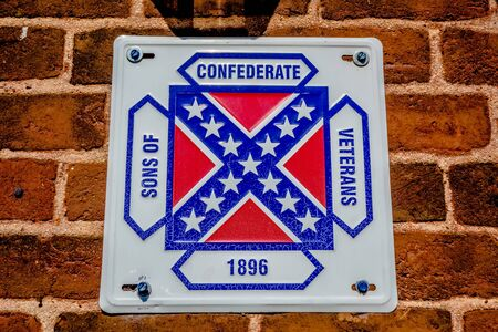 plaque: confederate flag plaque attached to brick wall Stock Photo