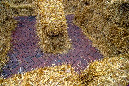 navigate: Maze for either people or livestock to navigate made from straw bales