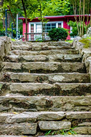 leading: stone steps leading to a mountain vacation home Stock Photo