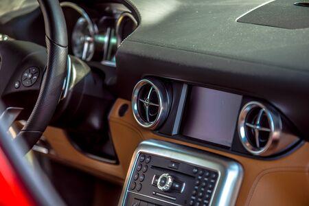 controls: luxury car interior dash steering wheel and controls Stock Photo