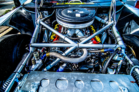 engine: racing car engine and wires under the hood Stock Photo