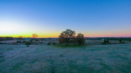 morning sunrise over frost covered farm land