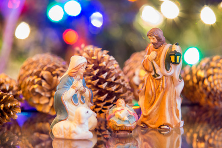 nativity set: nativity set with mary joseph and jesus with christmas lights background