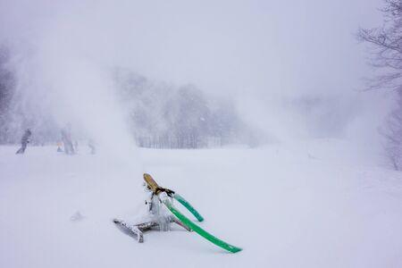 during: snowmaking during snow storm atski resort Stock Photo