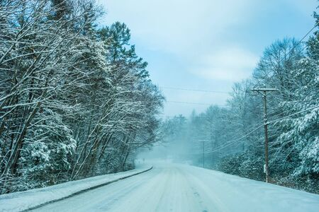 driving conditions: bad road conditions while driving in winter Stock Photo