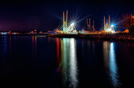 fishing boats in marina at night