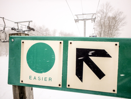 a slope: easier ski slope trail sign Stock Photo
