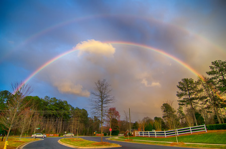 country roads: rainbow colors over country roads Stock Photo