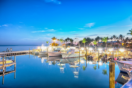 Florida Keys fishing boats in turquoise tropical blue water Banco de Imagens - 56432315