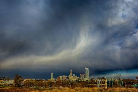scarry: stormy rain clouds over charlotte north carolina skyline