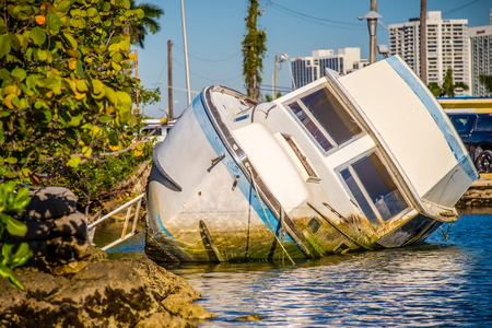 ship wreck: abandoned boat rotting in water