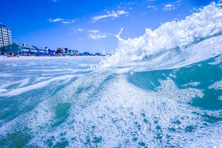 destin: blue crystal water waves crashing on beach