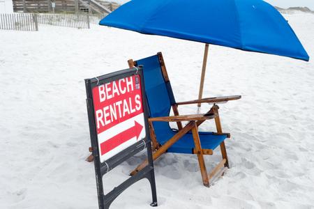 rentals: beach umbrella and chair rentals sign