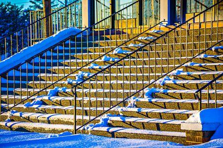 strairs handrail and shadows at sunset